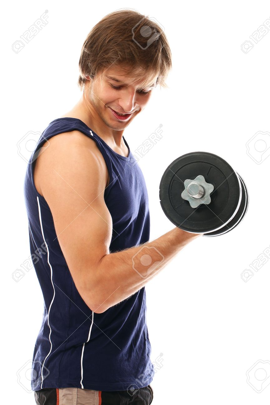 Handsome and sporty guy lifting dumbbell over a white background Stock Photo - 16833432
