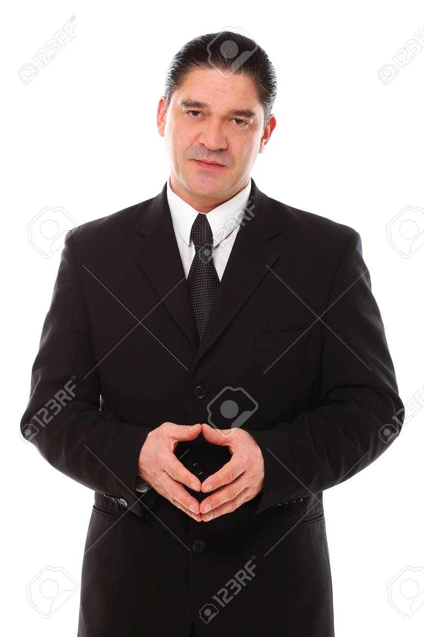 Confident mid aged man in suit posing in studio over a white background Stock Photo - 16832680
