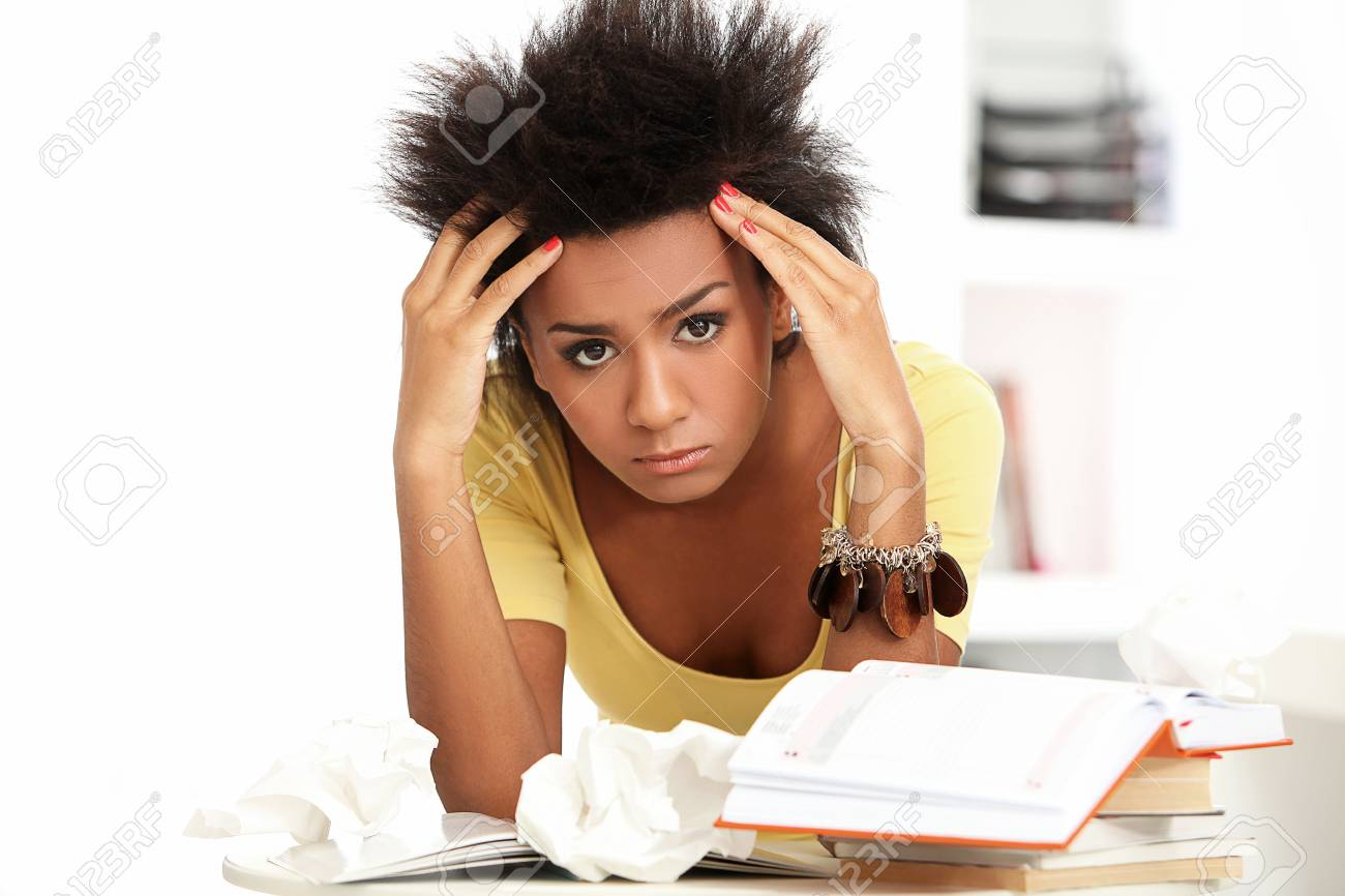 Young black woman tired from studying with books Stock Photo - 16997687