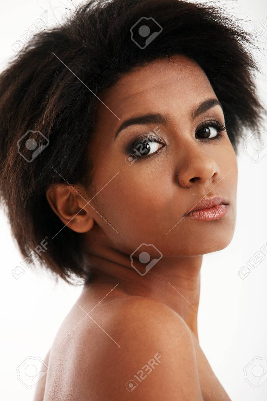 Beautiful and attractive black woman portrait isolated on a white Stock Photo - 16999104
