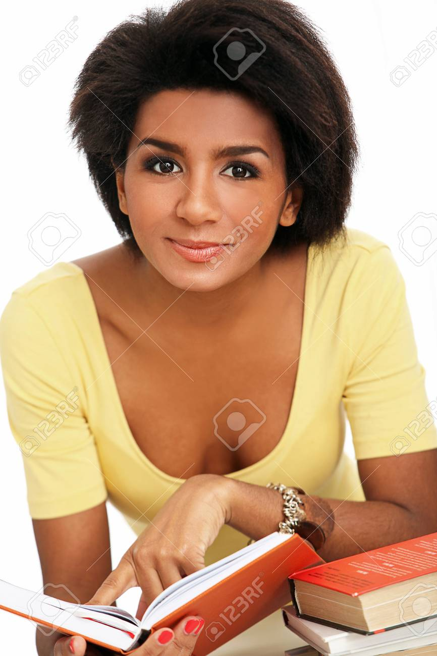 Young and beautiful afro woman studying with books Stock Photo - 16998983