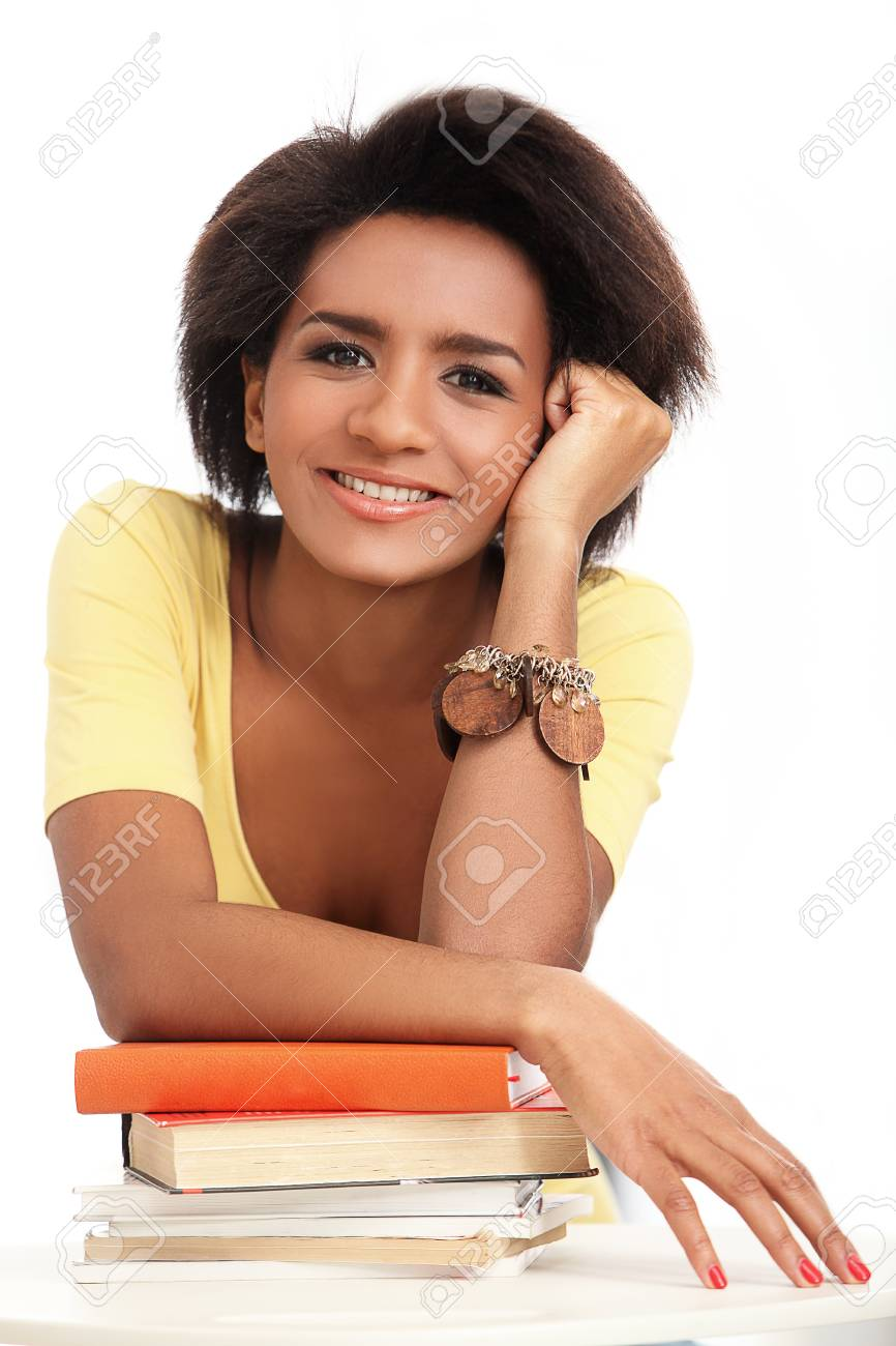 Young and beautiful afro woman studying with books Stock Photo - 16998765