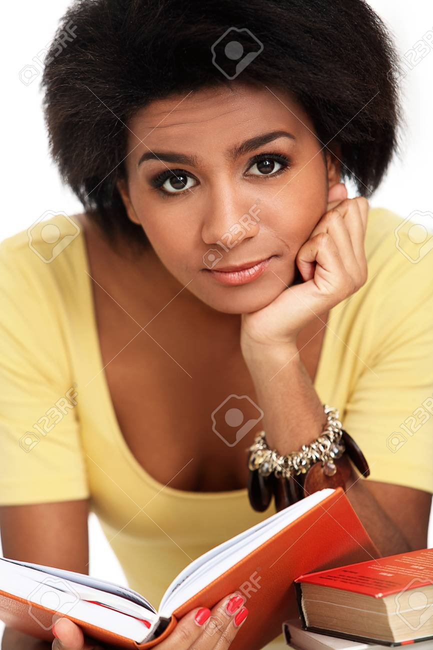 Young and beautiful afro woman studying with books Stock Photo - 16999078