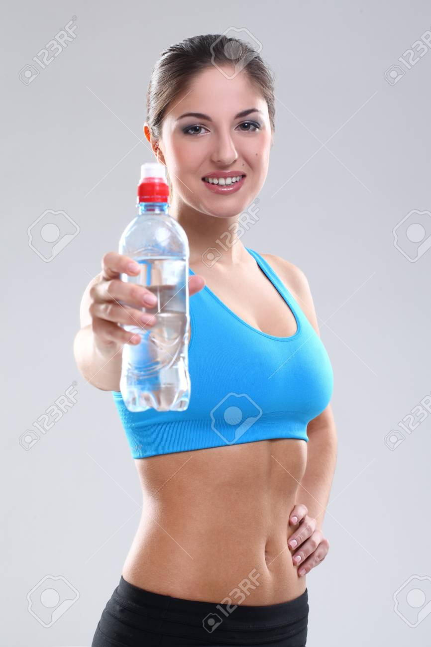 Beautiful caucasian woman with water in fitness wear over background Stock Photo - 19165075