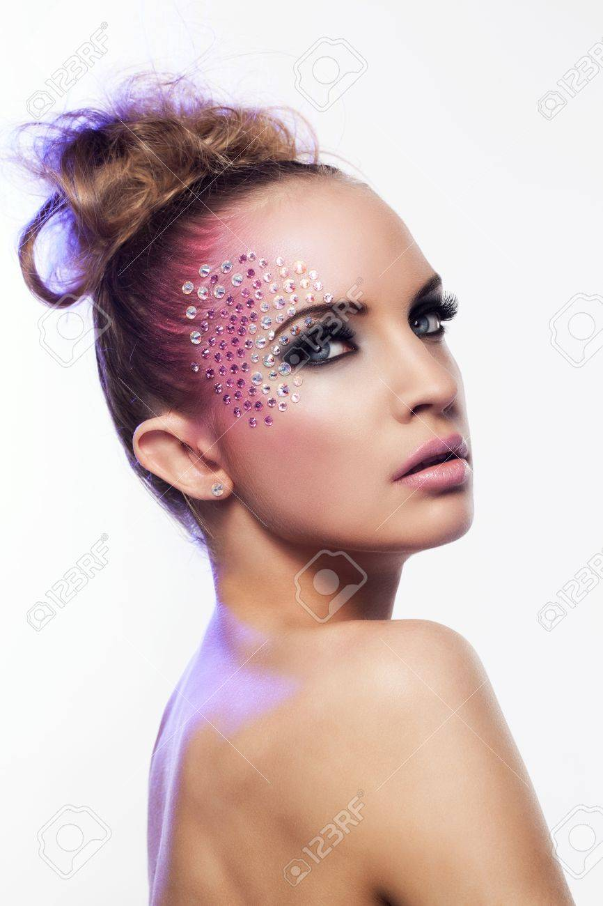 Beautiful woman with fantasy makeup on a white background Stock Photo - 19165101
