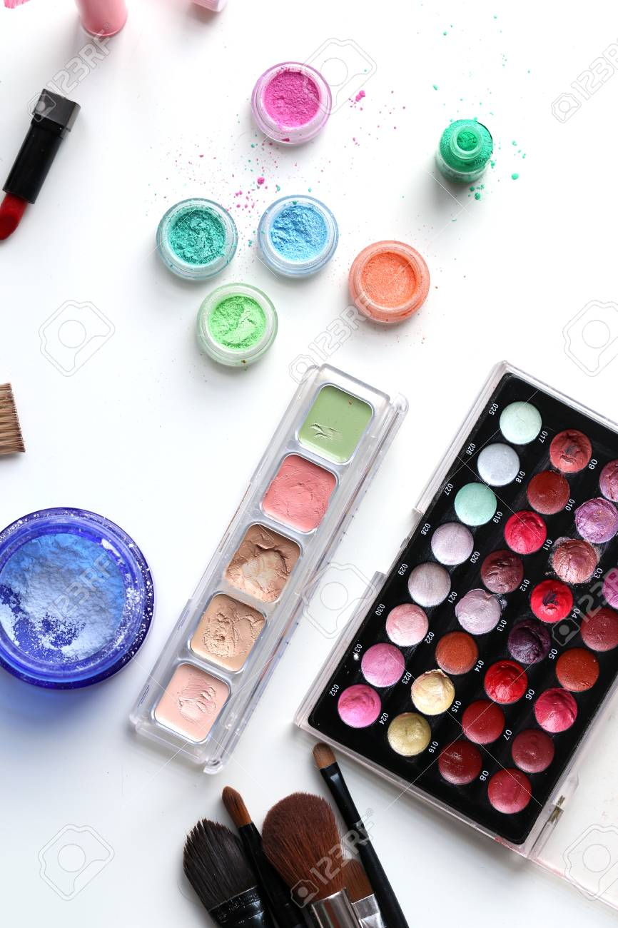 Picture of different-colored cosmetic powders with other cosmetic accessories Stock Photo - 23006630