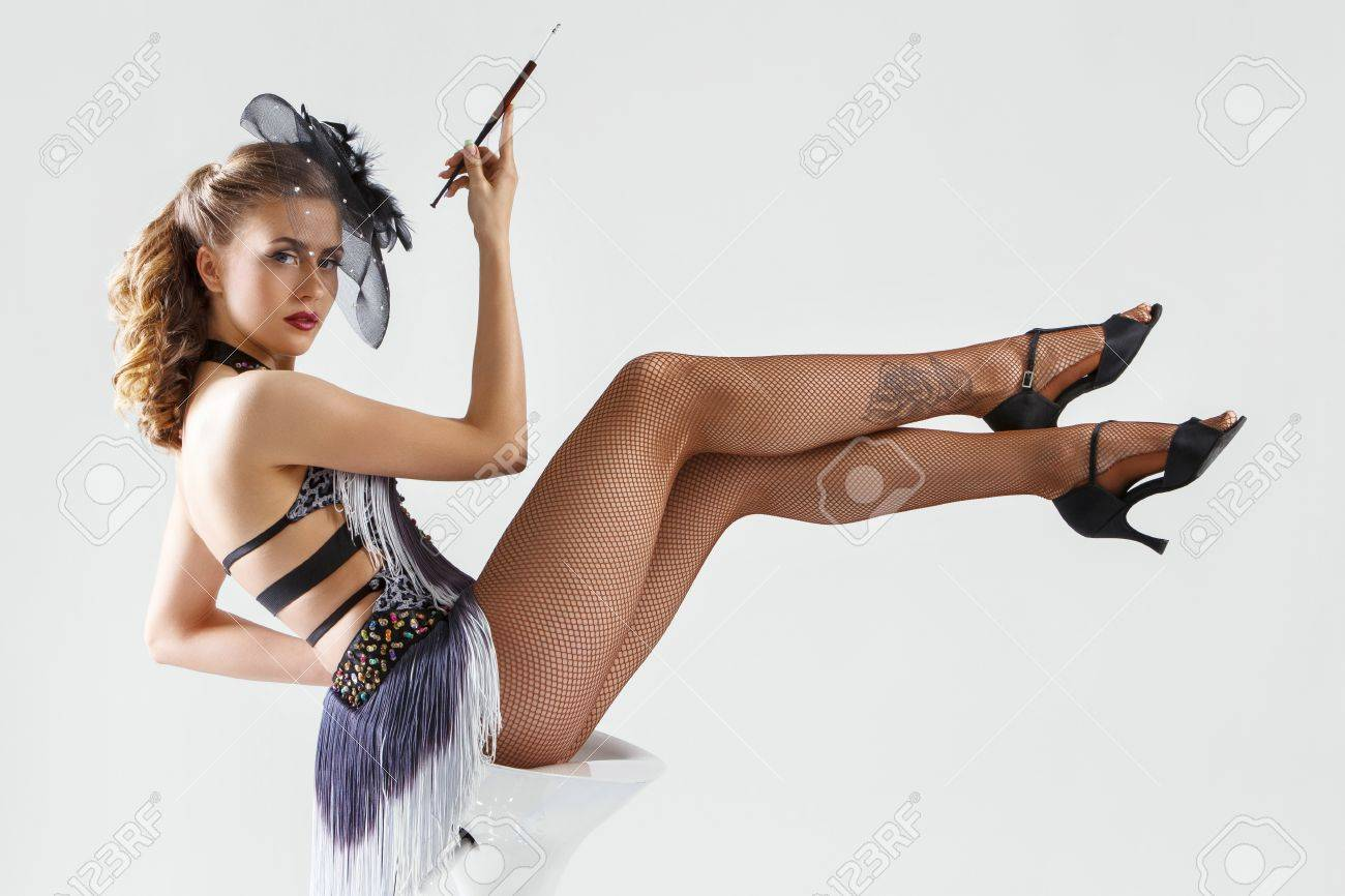 burlesque cute beautiful woman on a white background stock photo