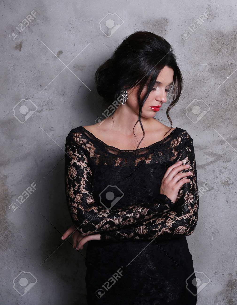 Beautiful woman with red lipstick and black
