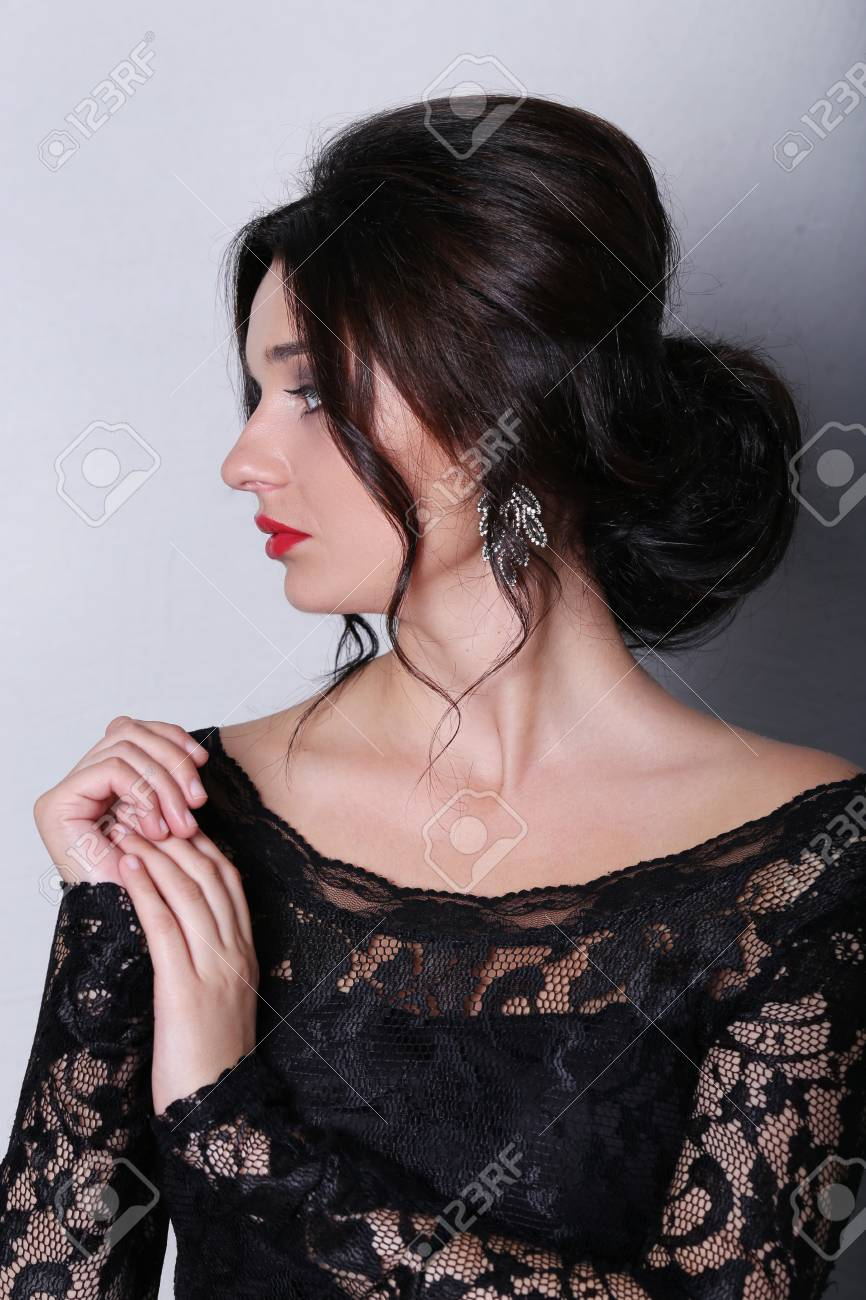 Beautiful Woman With Red Lipstick And Black Dress