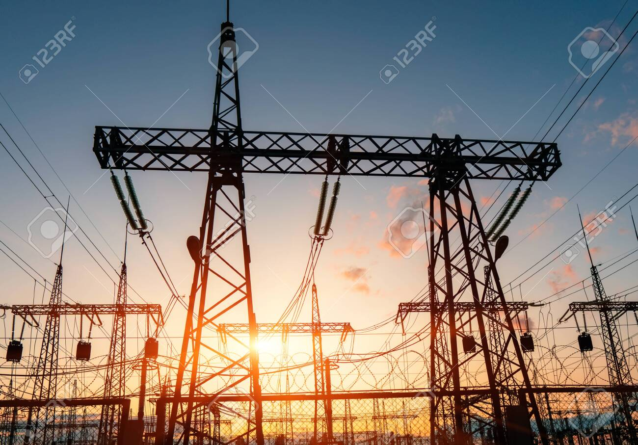 High-voltage power lines. Distribution electric substation with power lines and transformers. - 144839281