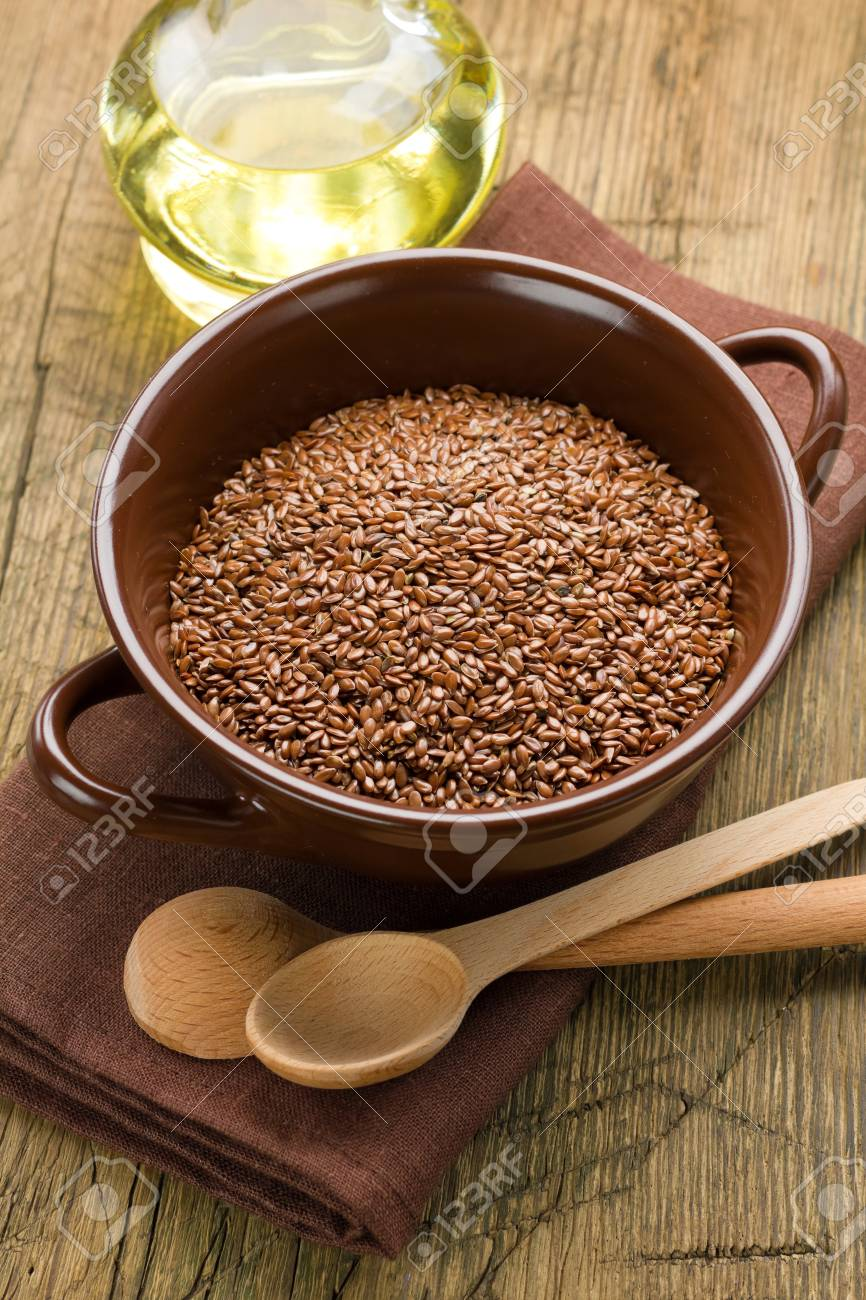 Linseed oil and flax seeds Stock Photo - 17194309