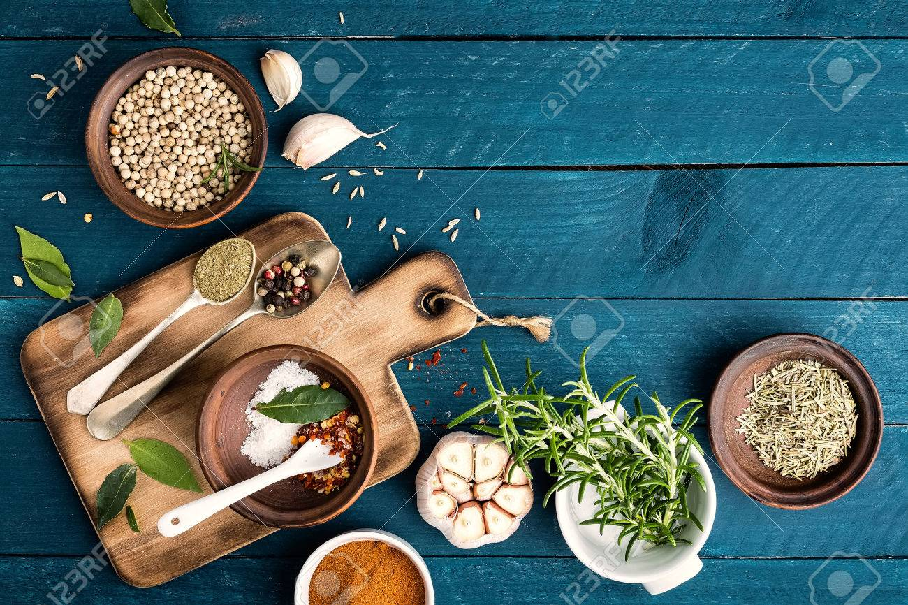 culinary background with spices on wooden table - 53694365