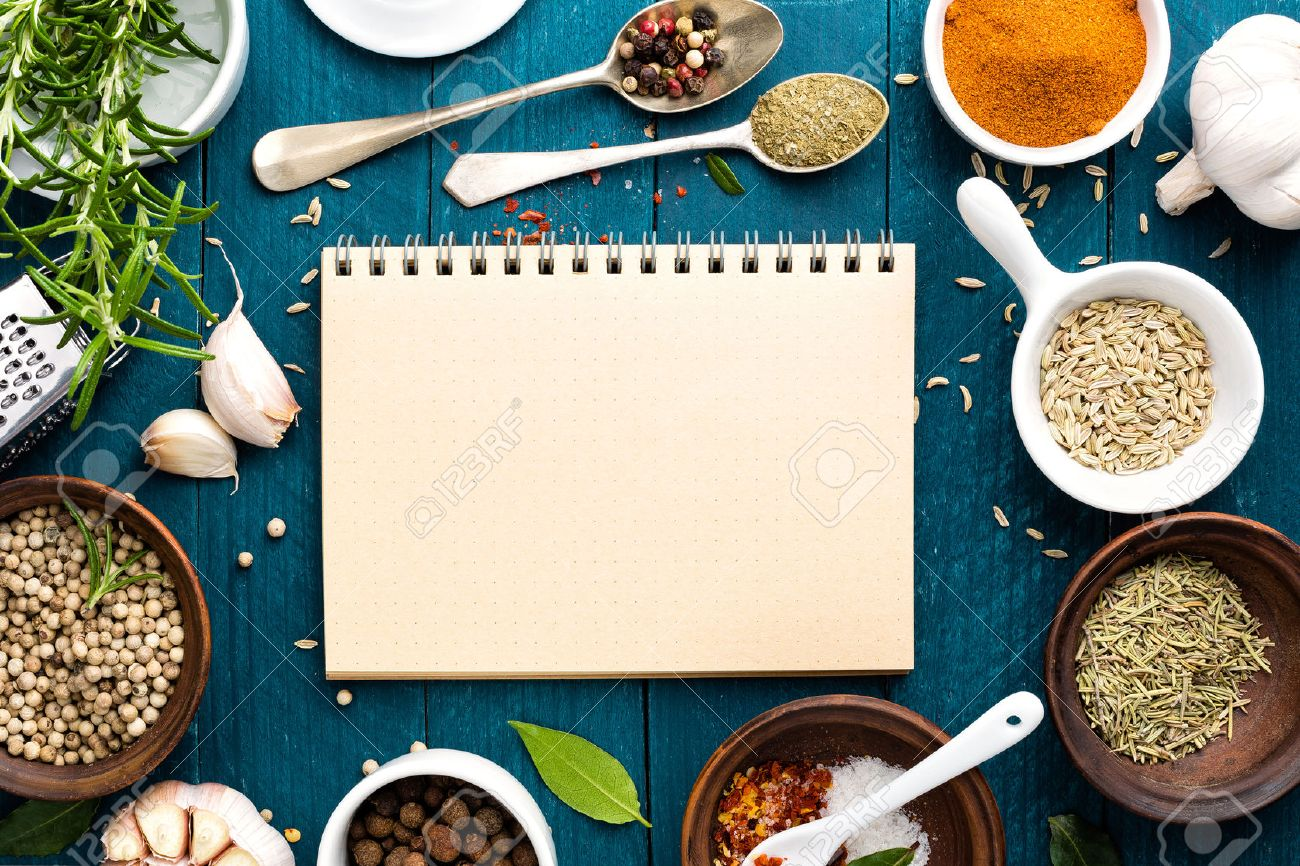 culinary background and recipe book with various spices on wooden table - 53694353