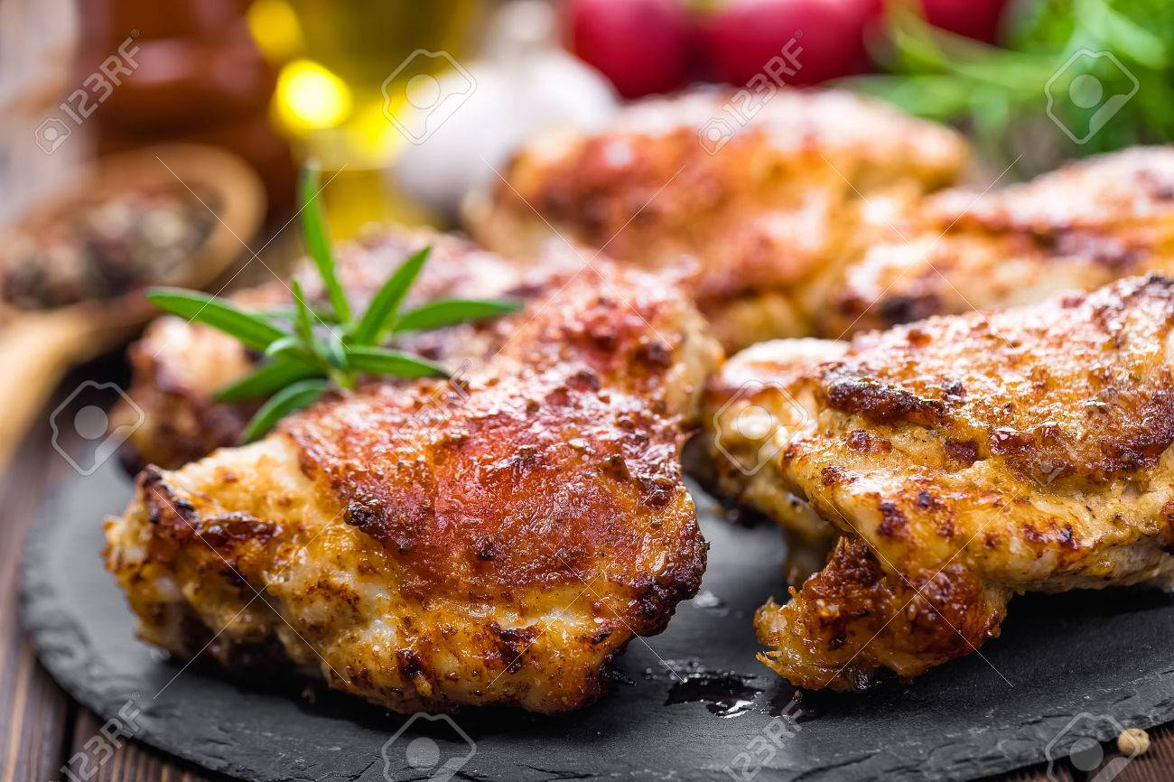 grilled chicken thighs prepared on wooden table - 54805340