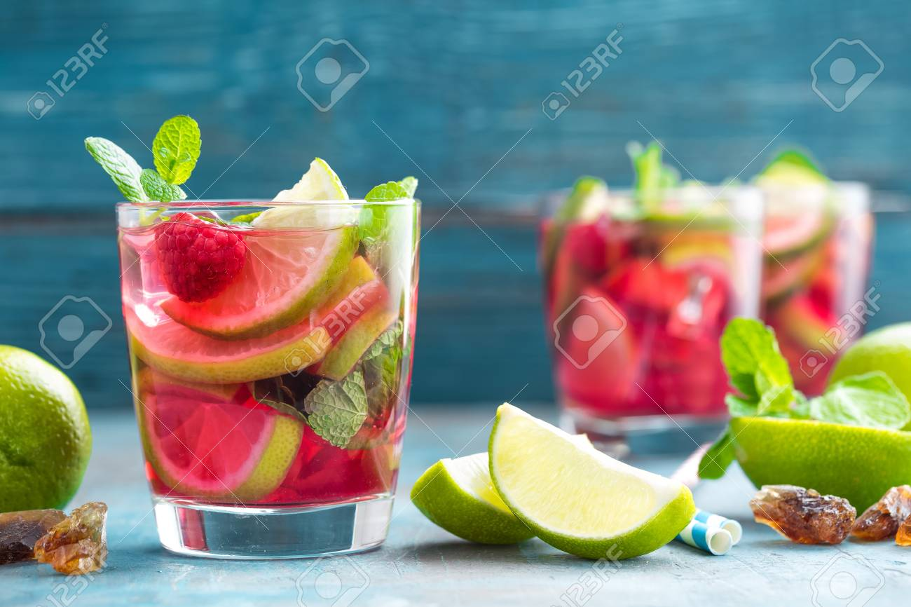 refreshing mint cocktail mojito with rum lime and raspberry