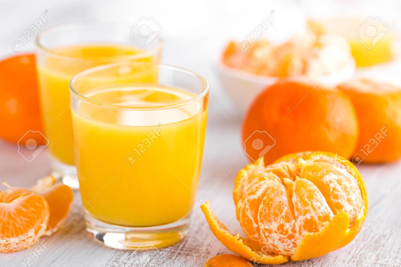 Tangerines, Peeled Tangerines And Tangerine Juice In Glass ...