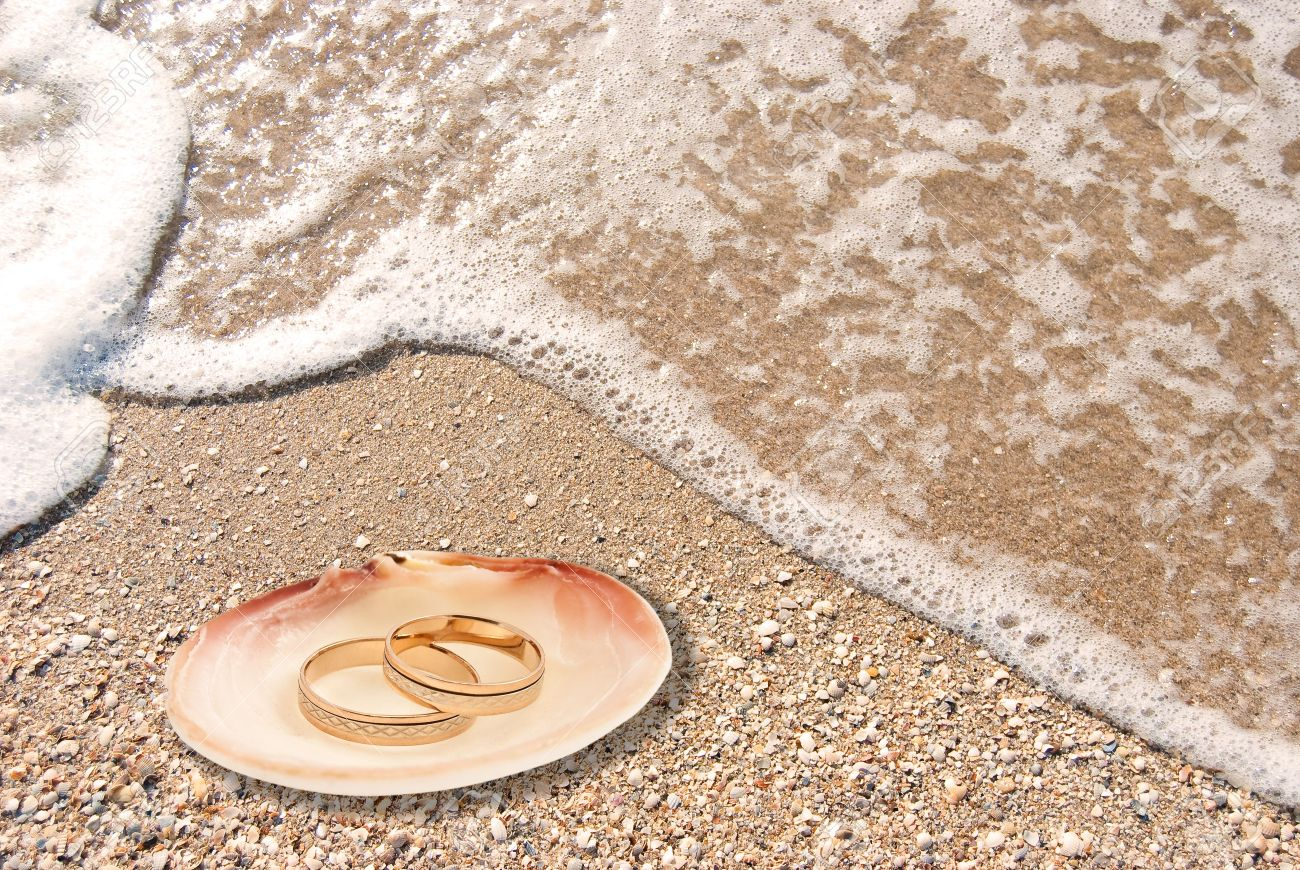rings close photo sand in wedding beach the two up on shell a ceremony