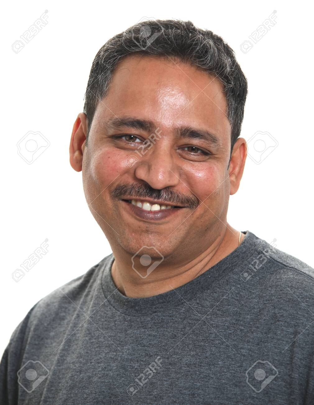 A smiling Indian man in a studio against a white background - 143874999