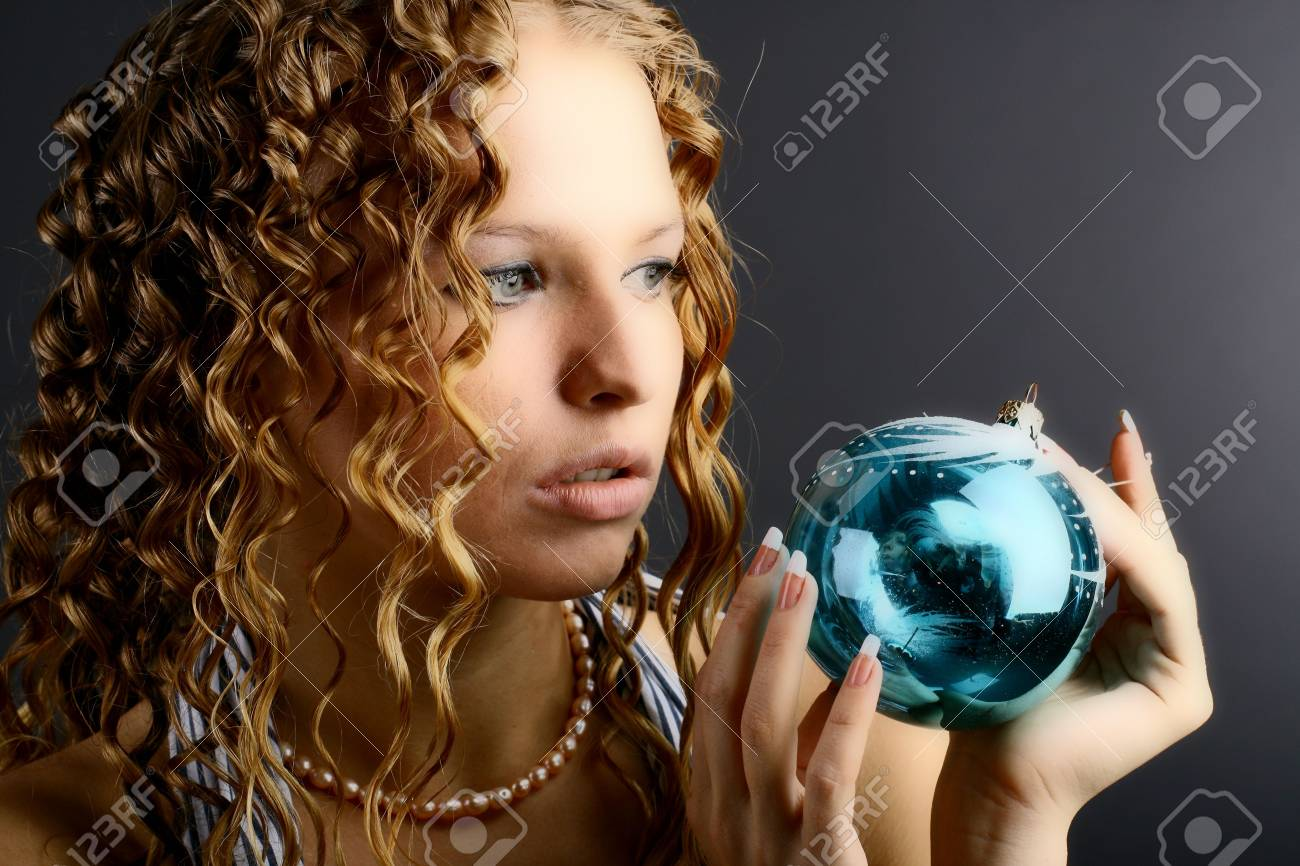 The girl with a magic New Year's sphere is very surprised holidays Stock Photo - 2143746