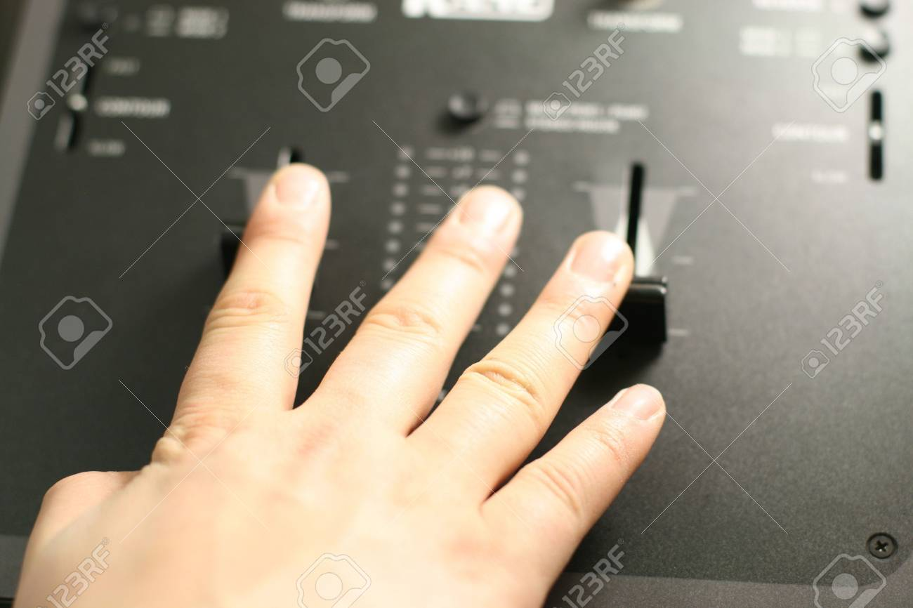 scratch battle of dj playing on his vinyls hand on Stock Photo - 2475342