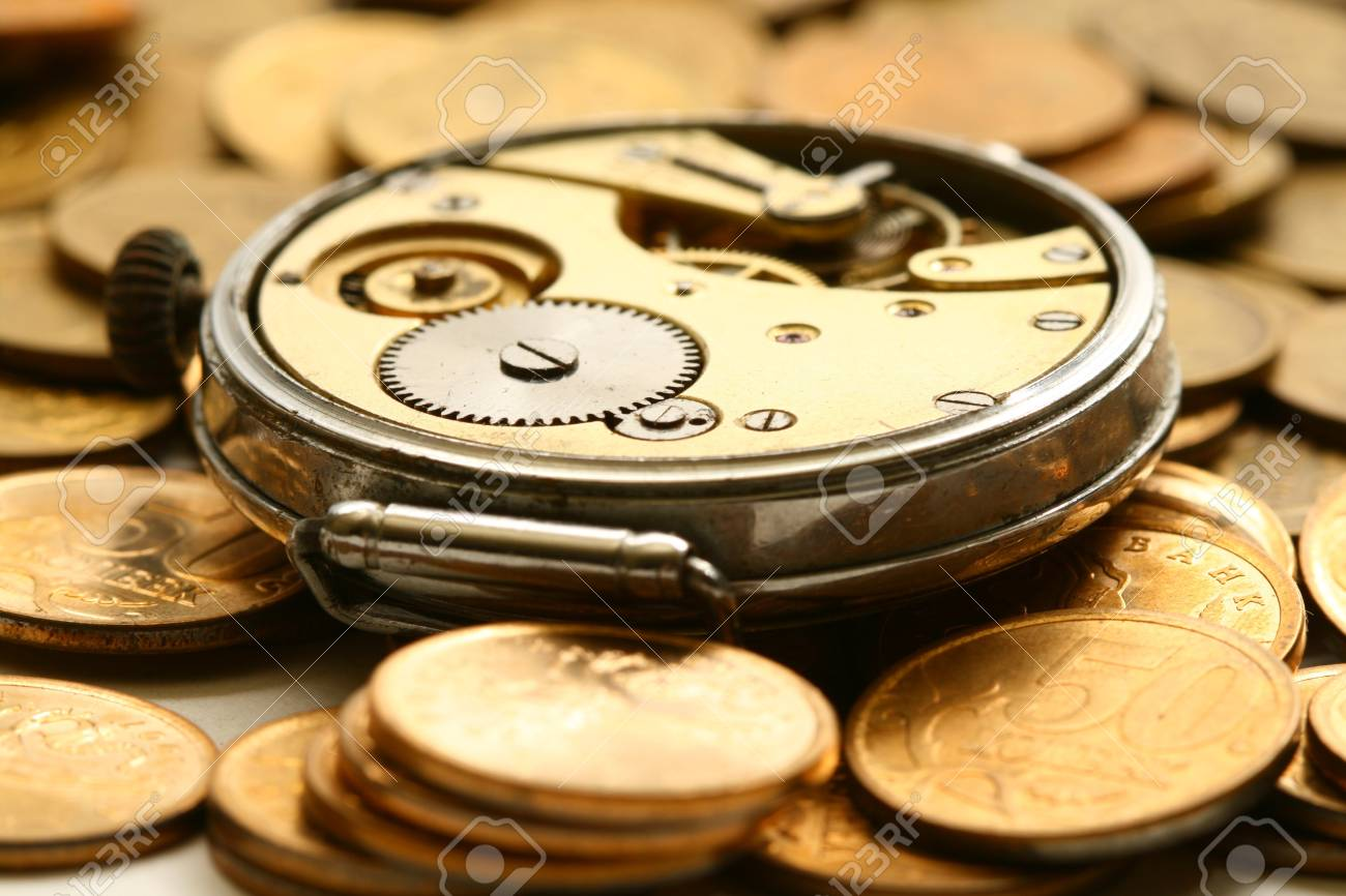 time is money coins and clock macro concet Stock Photo - 4363592