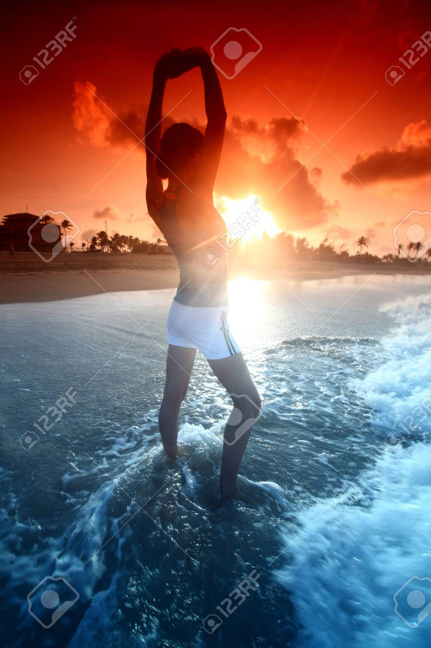 girl stay in ocean and say hello sun Stock Photo - 4975792