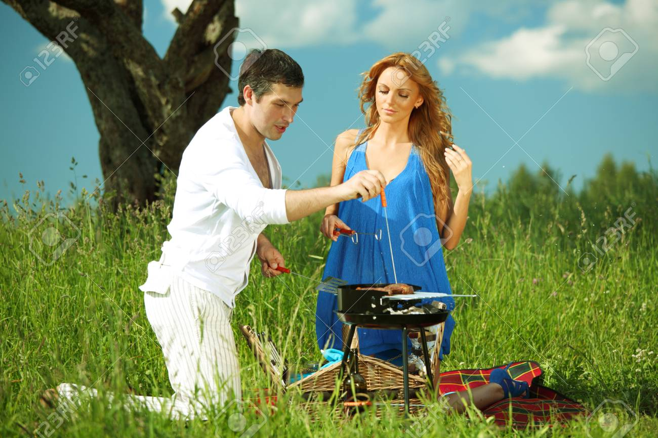 lovers on picnic cook steak Stock Photo - 8414574