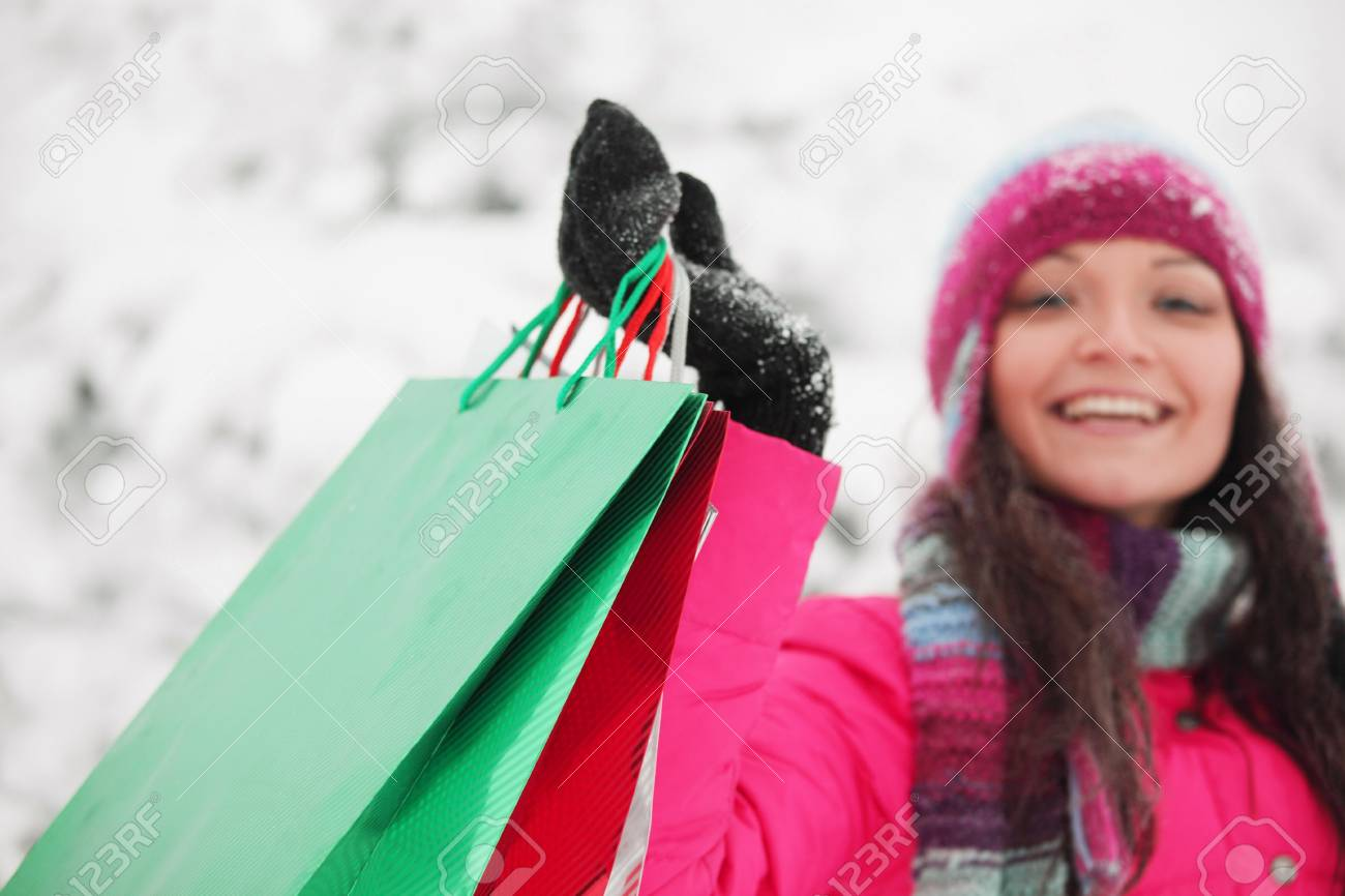 winter girl with gift bags on snow background Stock Photo - 8438134