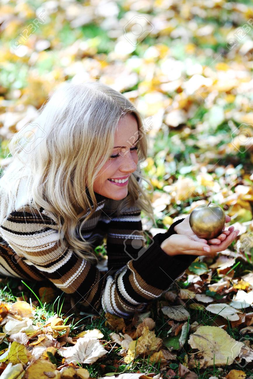 woman with golden apple in autumn park Stock Photo - 8587971