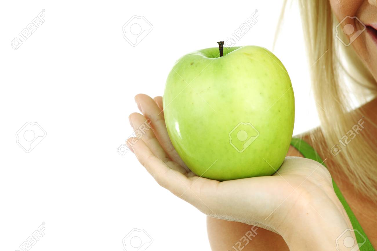 green apple in woman hands Stock Photo - 8585249