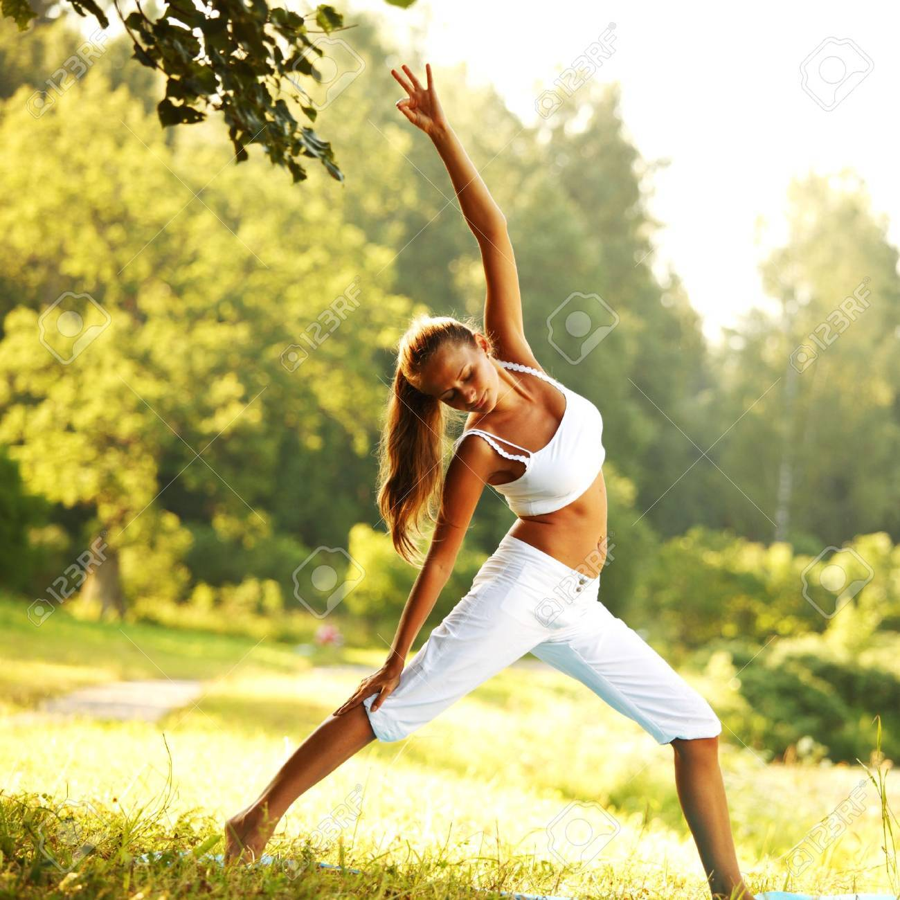 yoga woman on green park background Stock Photo - 8586216