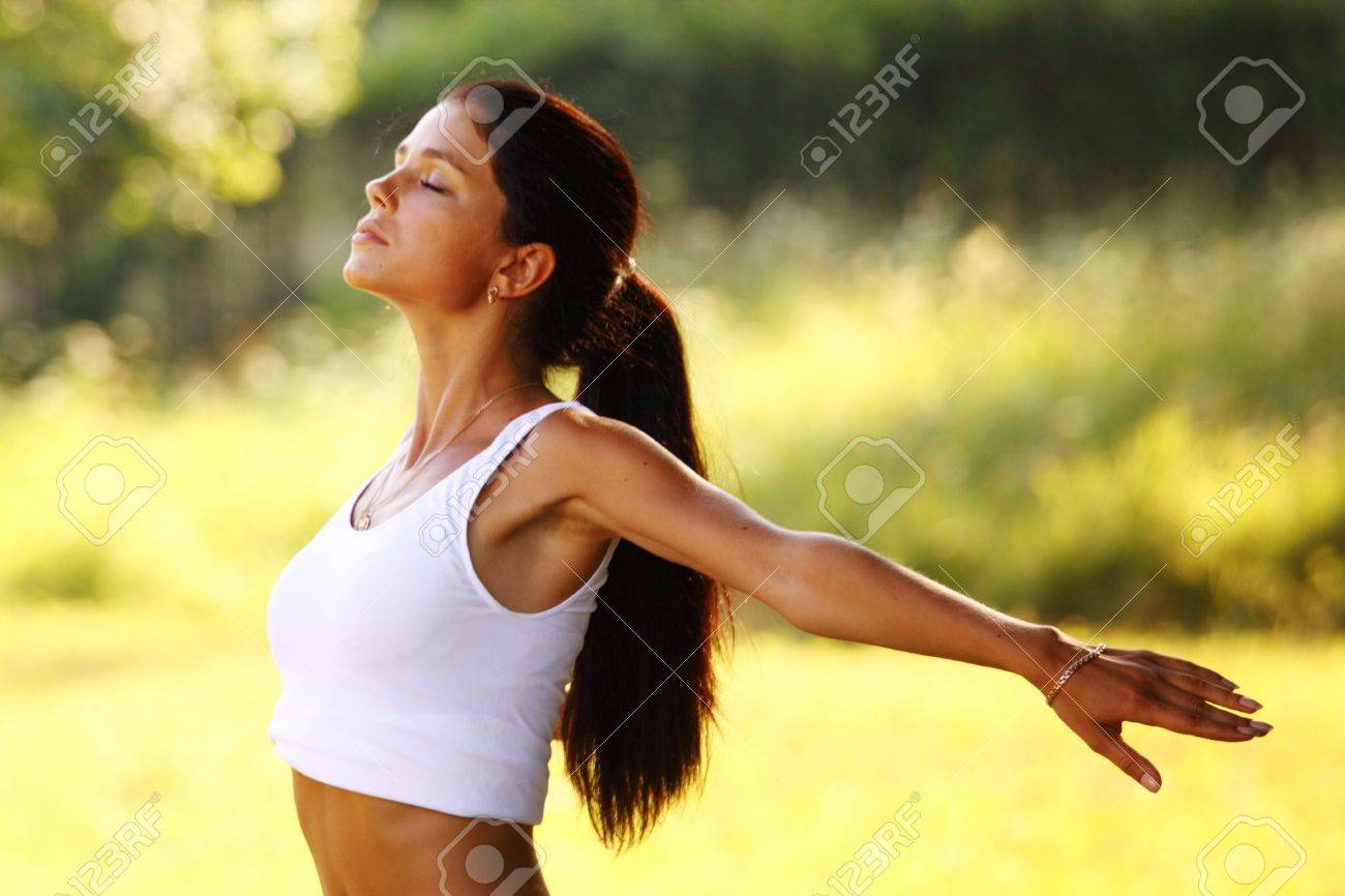 yoga woman on green park background Stock Photo - 8672856