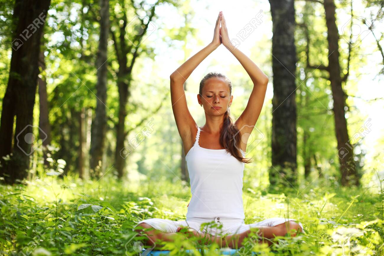 yoga woman on green grass in forest Stock Photo - 8743891