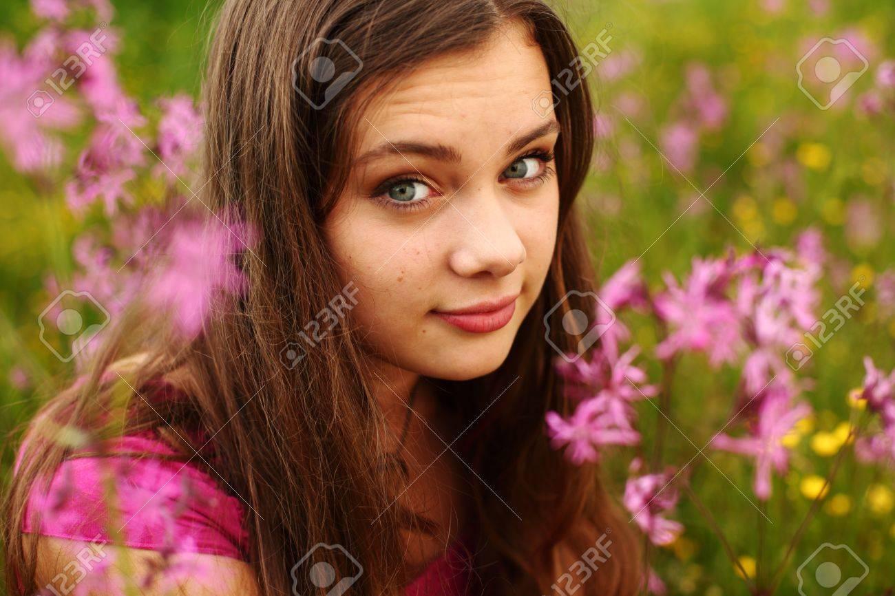 woman on pink flower field close portrait Stock Photo - 8743887
