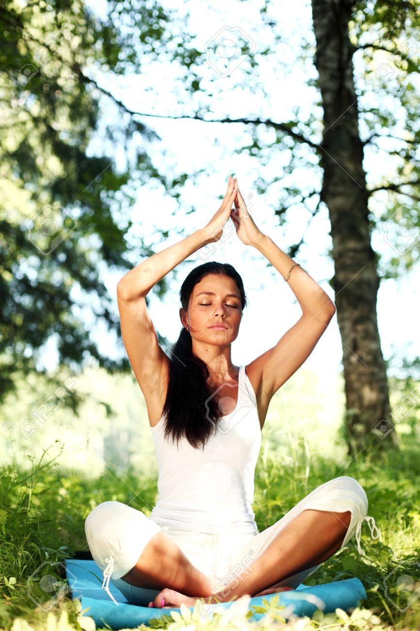 yoga woman on green grass in lotus pose Stock Photo - 8743861
