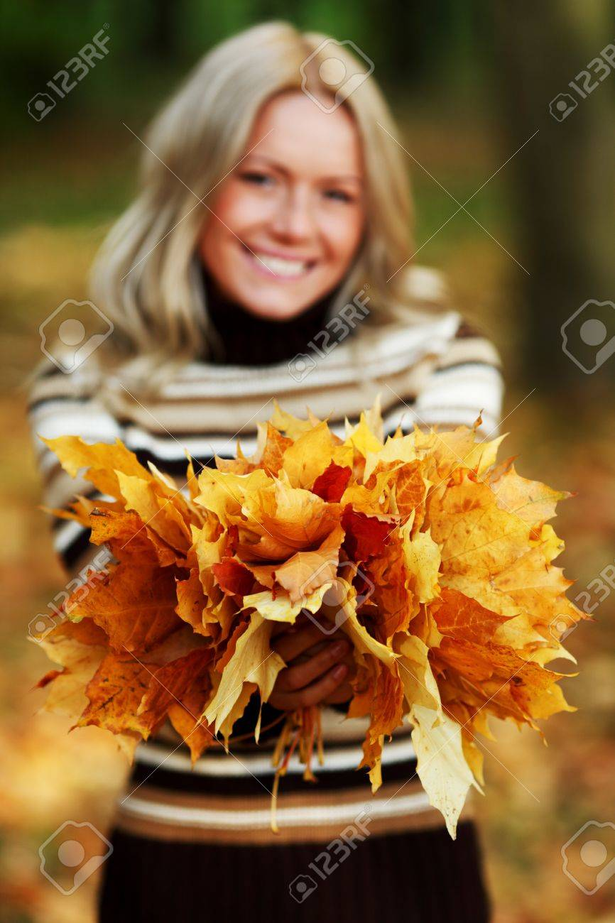 woman portret in autumn leaf close up Stock Photo - 8744035