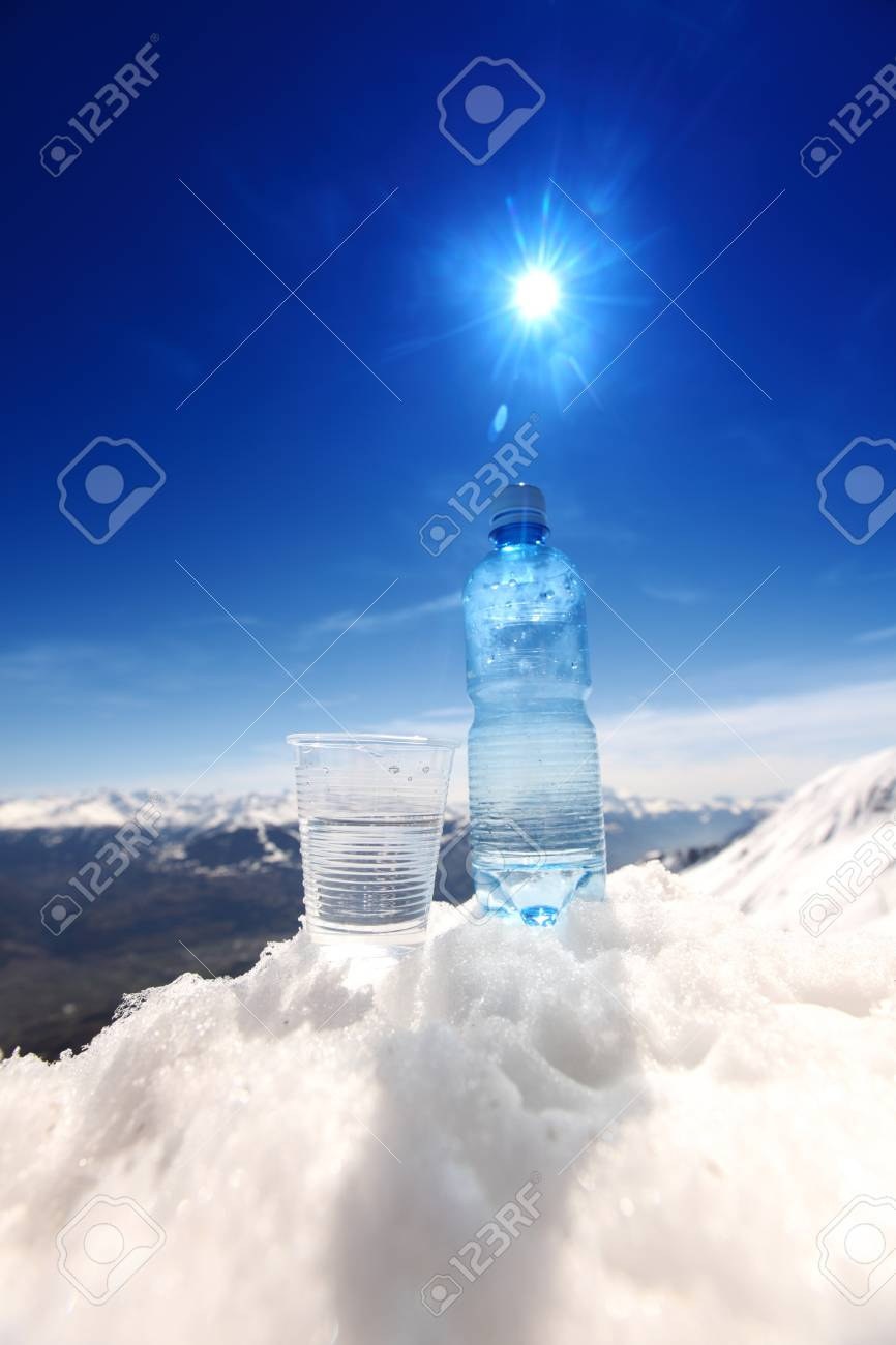 water in cup mountains on background Stock Photo - 8746082