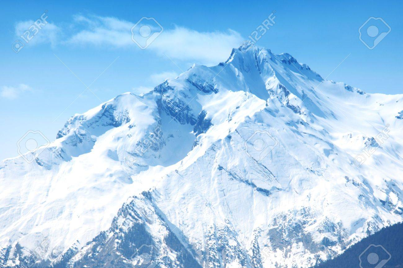 top of mountains sun in blue sky Stock Photo - 8822081