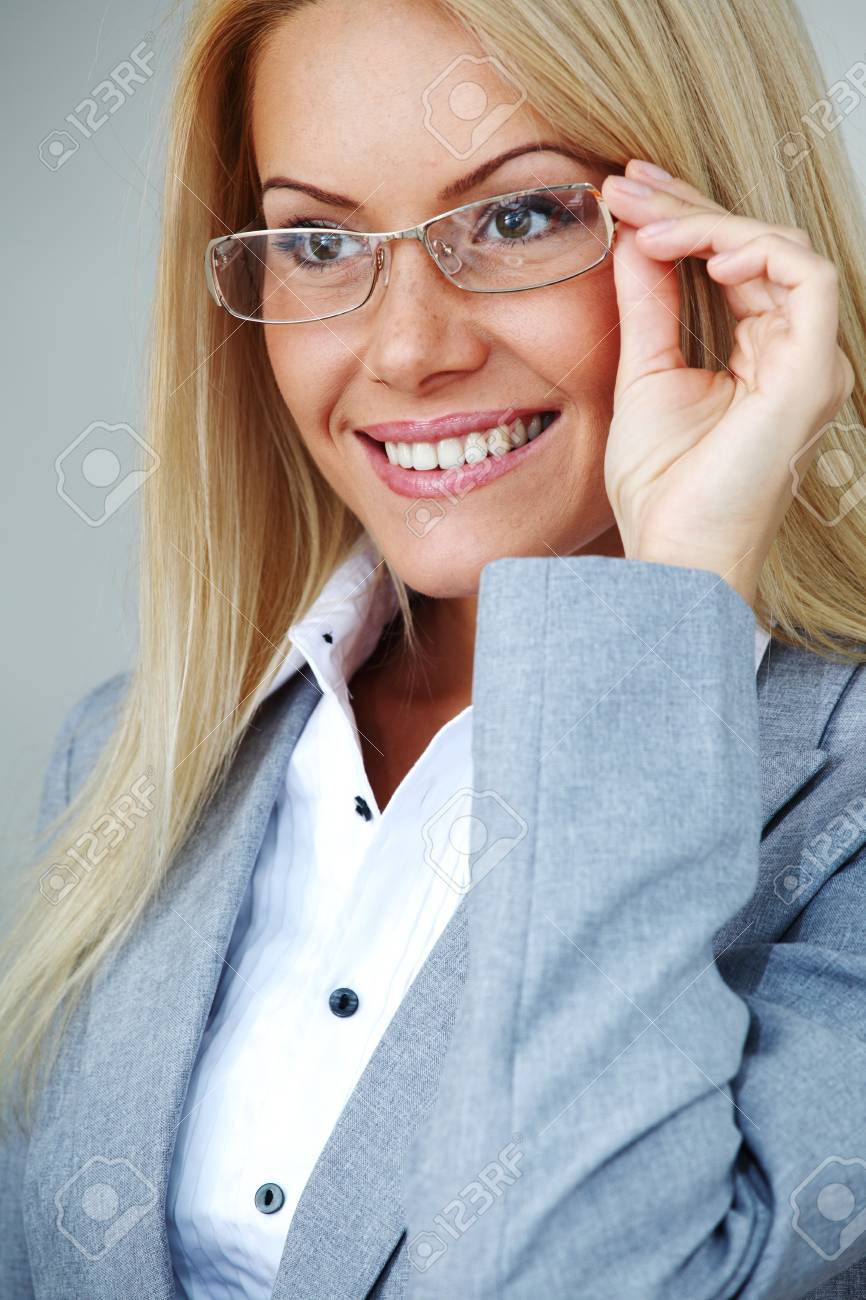 business woman in glasses on gray background Stock Photo - 8917531