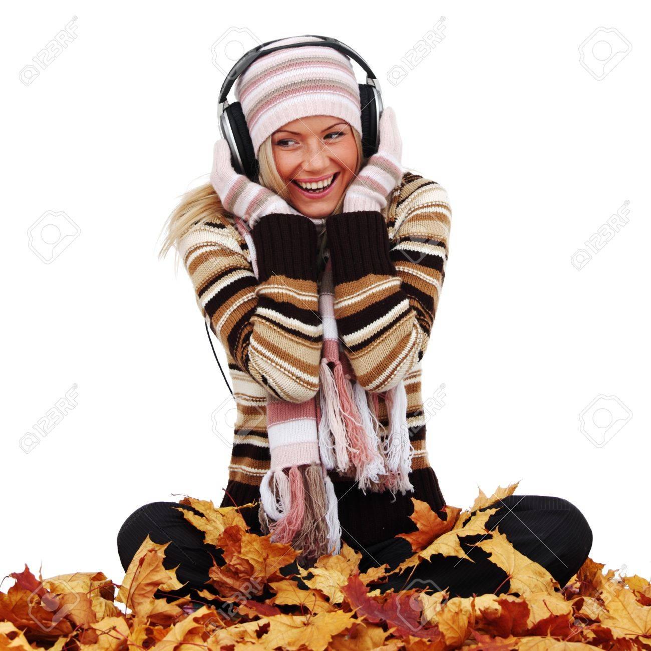 autumn woman listening music in studio Stock Photo - 9006795