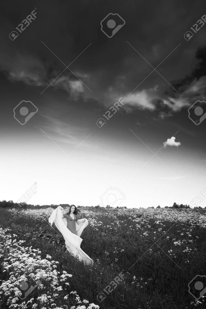 girl run by field fabric in hands fly behind like wings Stock Photo - 9129779