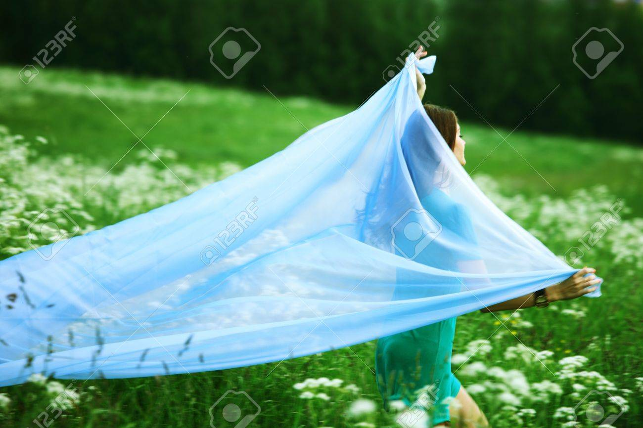 girl run by field fabric in hands fly behind like wings Stock Photo - 9122110