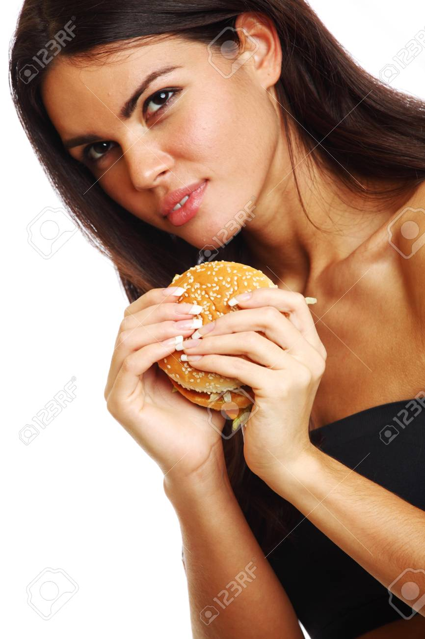 woman eat burger isolated on white background Stock Photo - 9173889