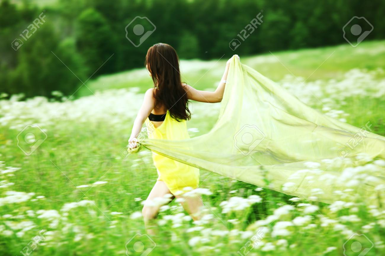girl run by field fabric in hands fly behind like wings Stock Photo - 9590545
