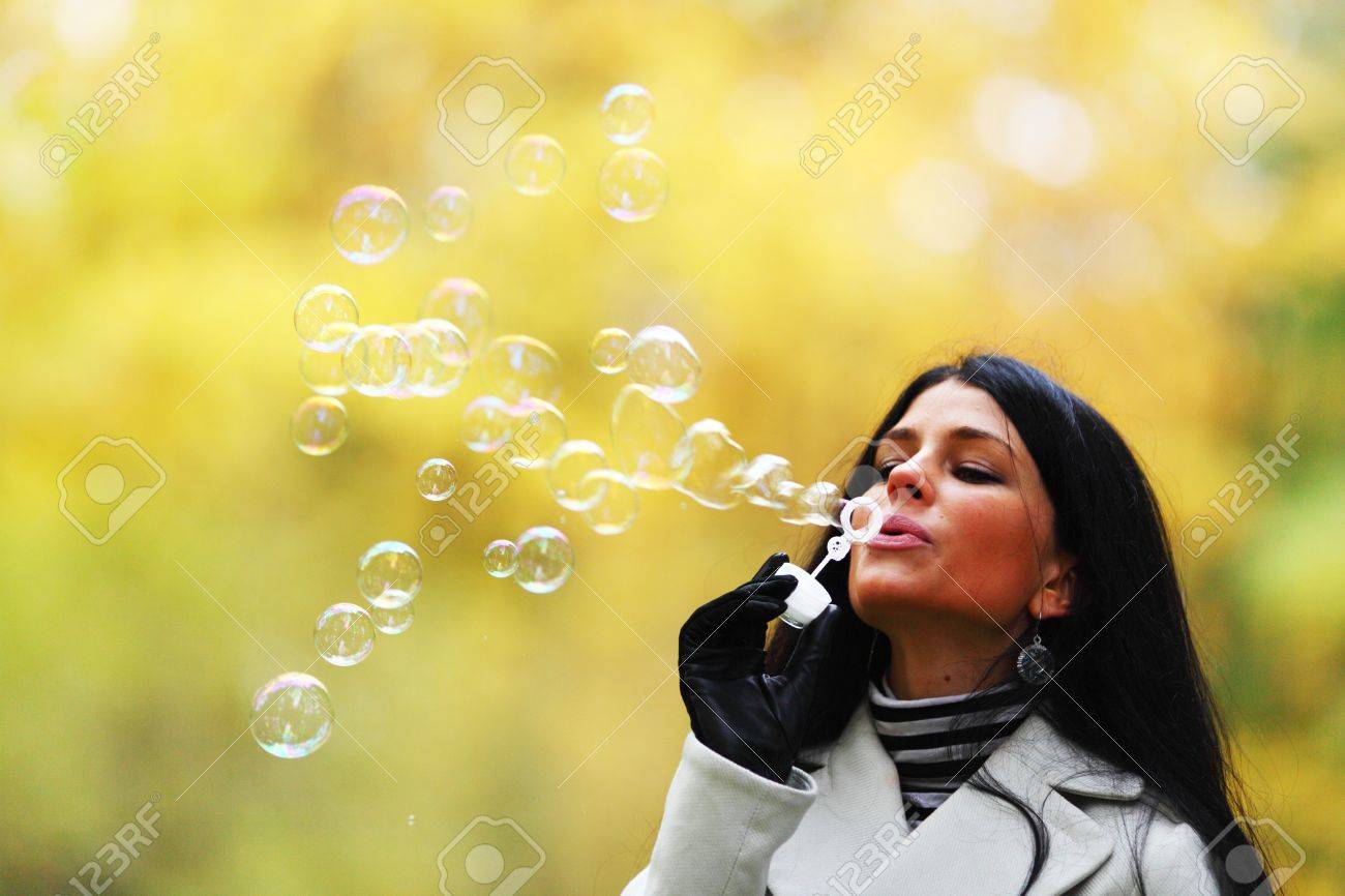 autumn woman blow bubbles portrait in park Stock Photo - 9864931