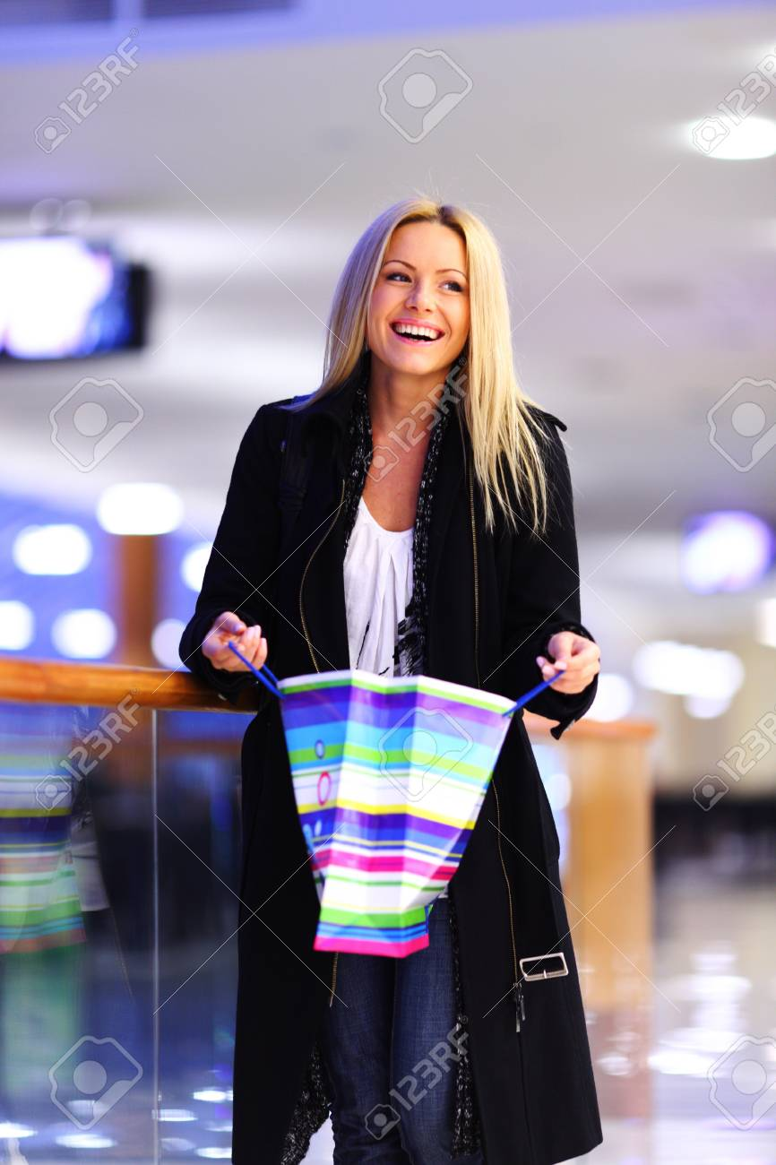 woman in shop center holds the bag in hands Stock Photo - 9906877
