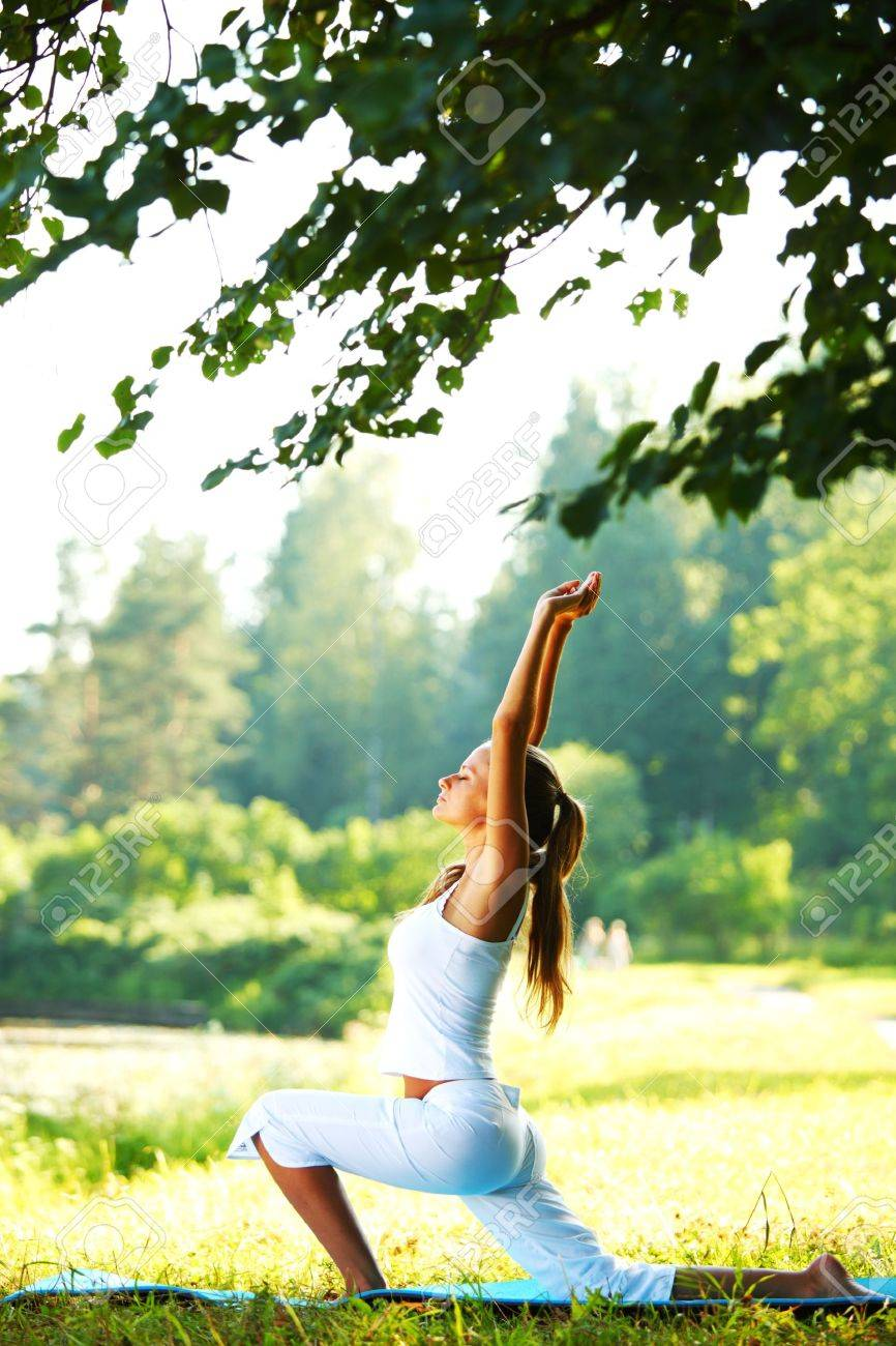 yoga woman on green park background Stock Photo - 9961606