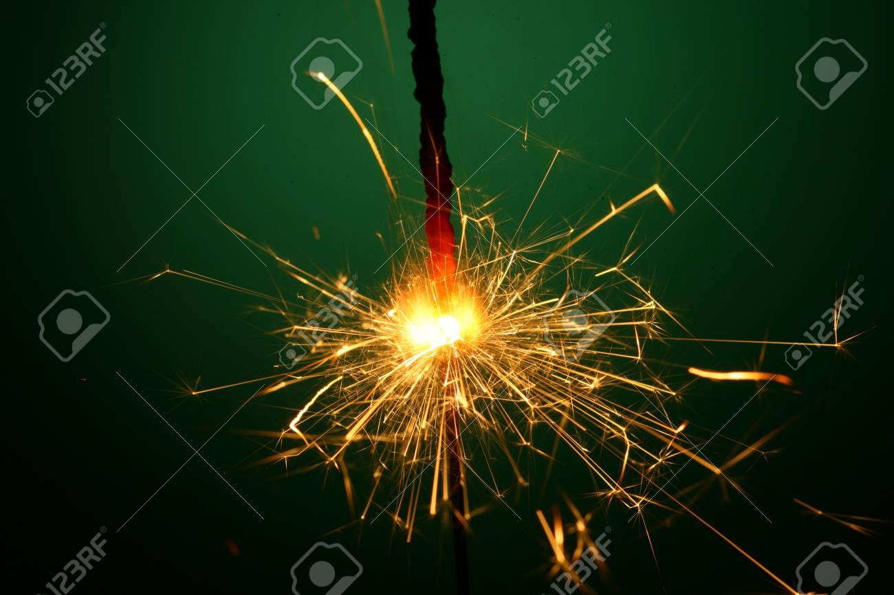 christmas sparkler on green background Stock Photo - 10001927