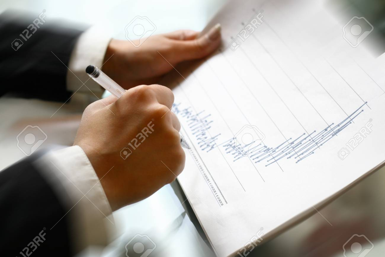 read the graph in financial report Stock Photo - 10073698