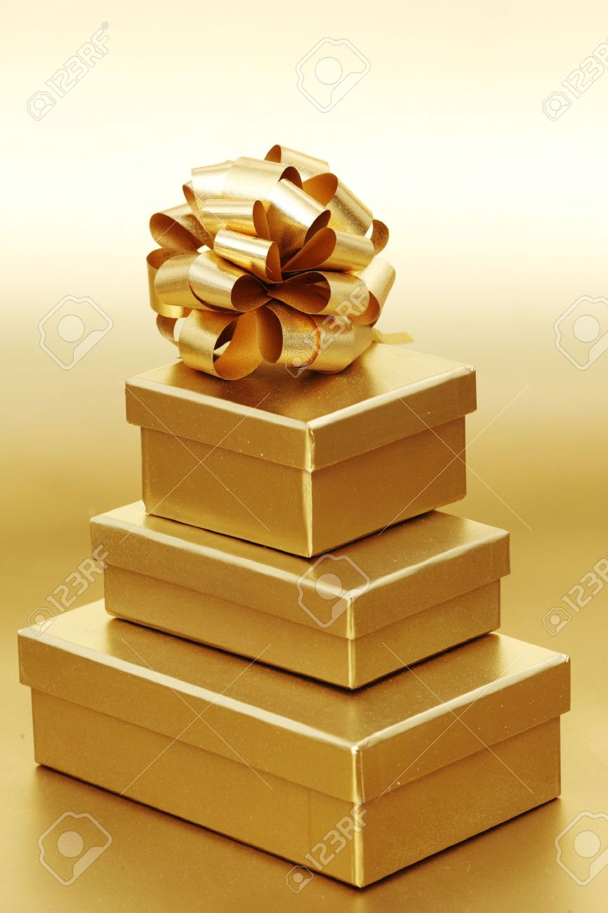 golden christmas gifts on gold background Stock Photo - 10254877